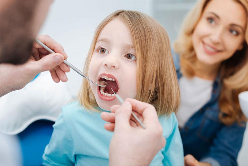Children's Dentist Operating on a kid in Regina, SK