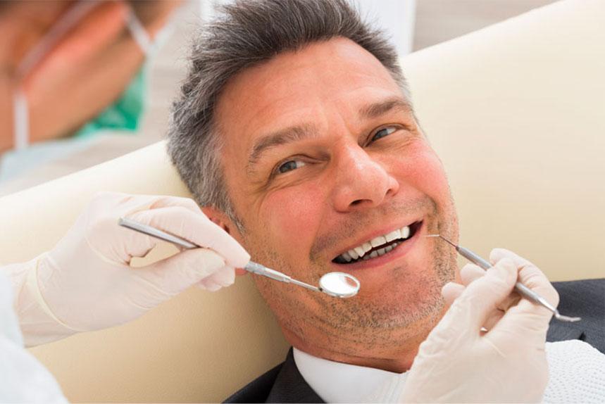 Patient Undergoing Dental Bridge Procedure in Regina, SK