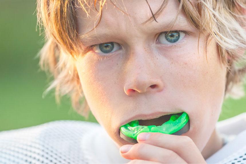 Boy Wearing Customized Dental Mouth Guard in Regina, SK